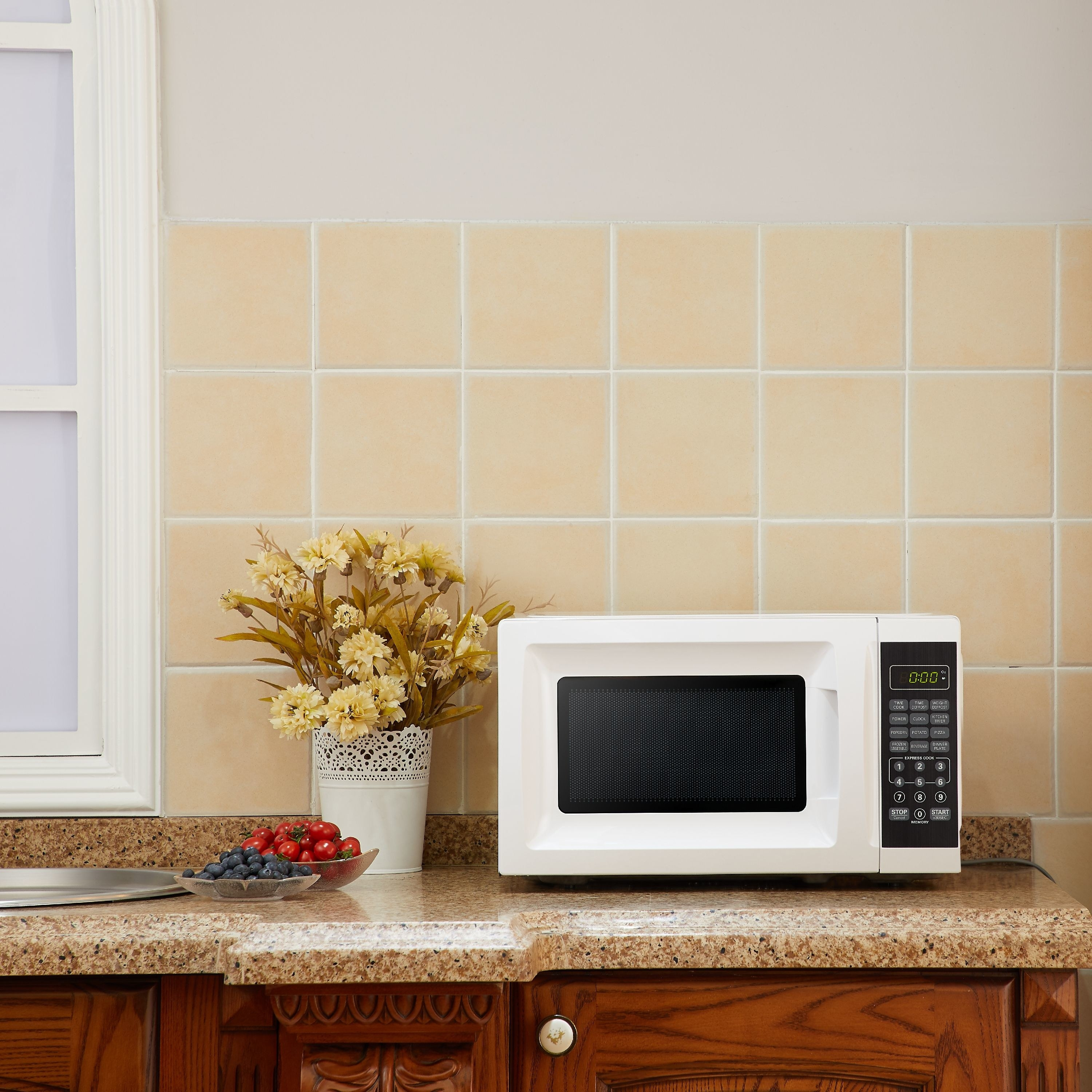 white microwave oven on counter