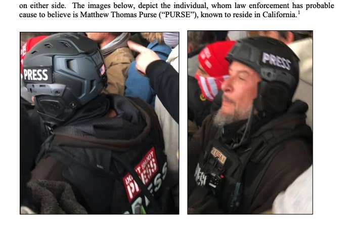 """A man in tactical gear with """"PRESS"""" written in multiple places on his back, chest, and helmet"""