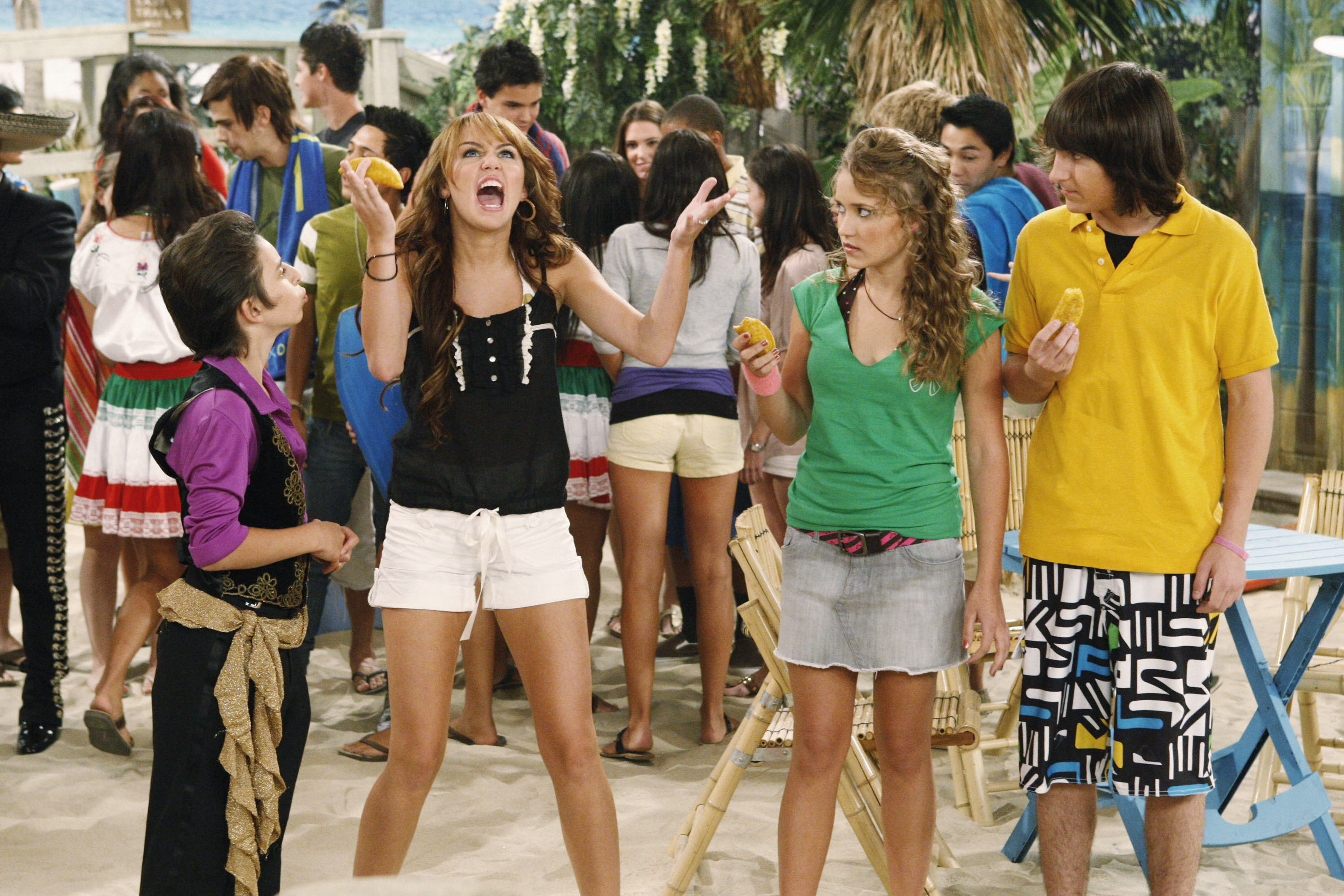 Moises Arias, Emily Osment, and Mitchel Musso watch Miley Cyrus scream on a beach
