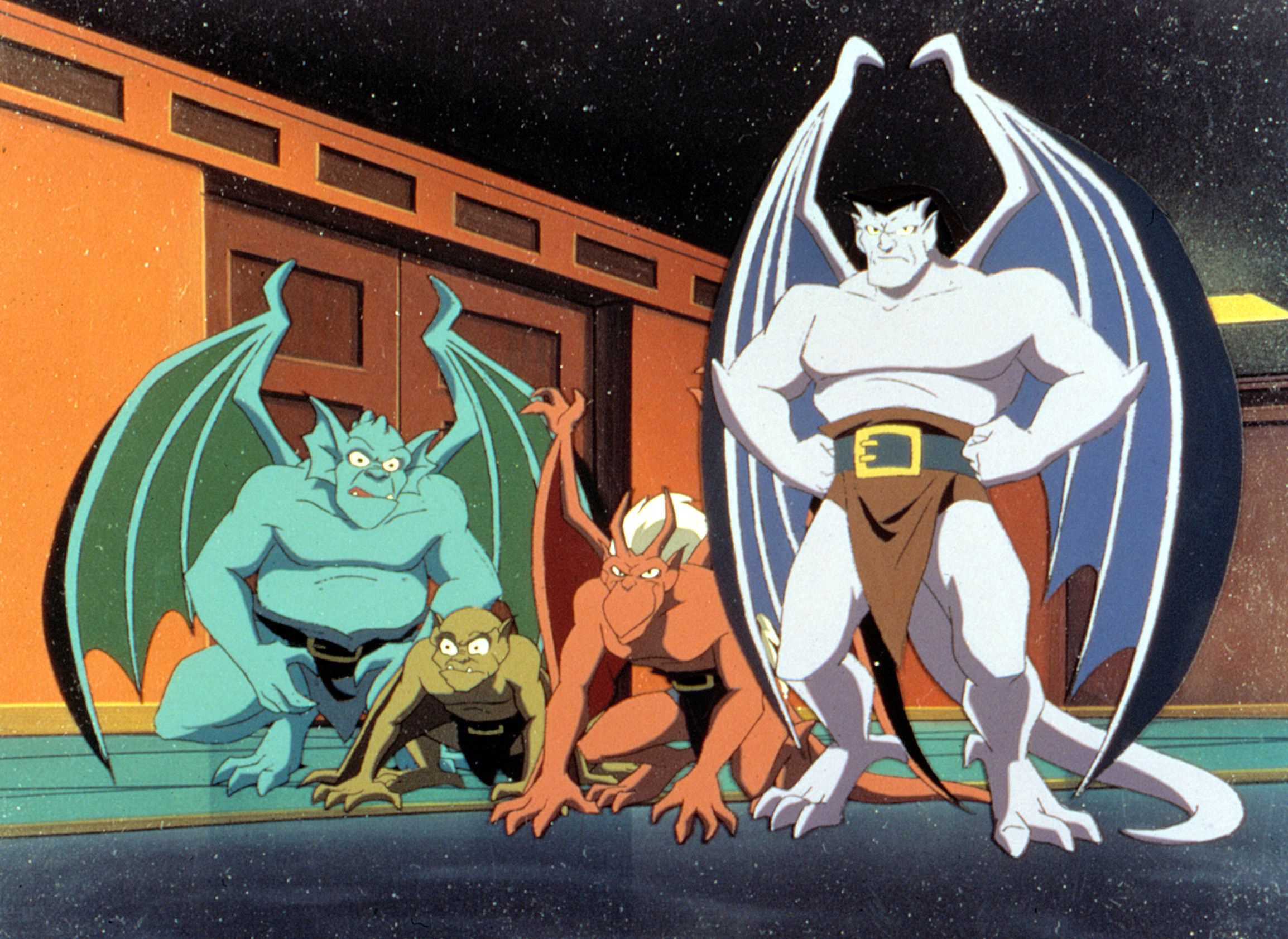 A group of gargoyles sit perched