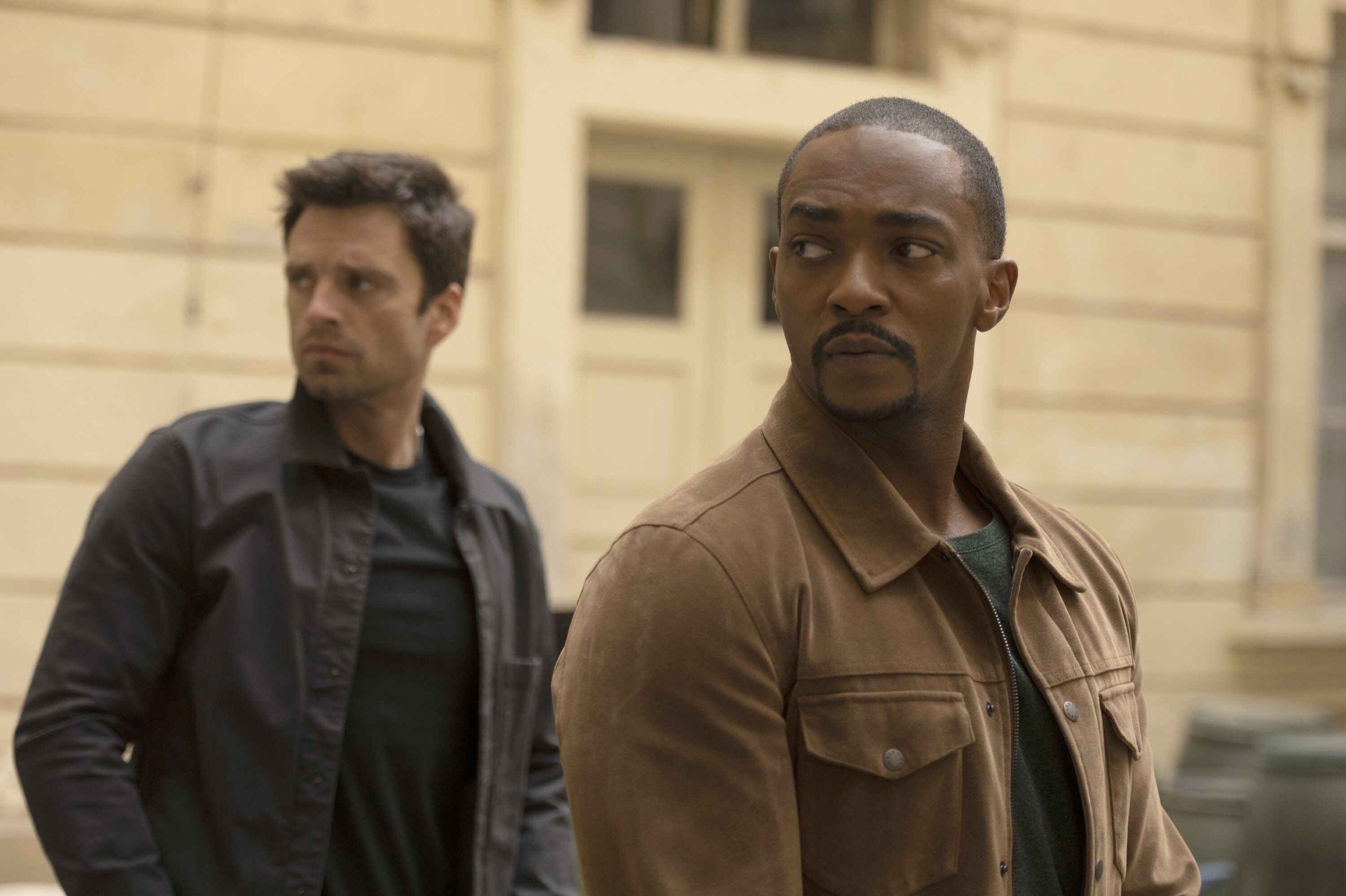Sebastian Stan and Anthony Mackie look over their shoulders
