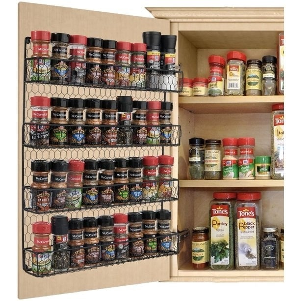 The three-tier wire rack holding spices