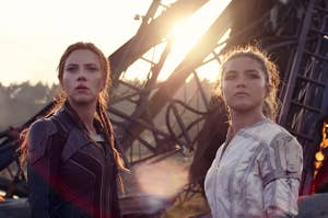 Scarlett Johansson and Florence Pugh in Black Widow. They're wearing battle suits and standing in front of rubble, looking towards the camera but not at it. (CREDIT: Marvel Studios)