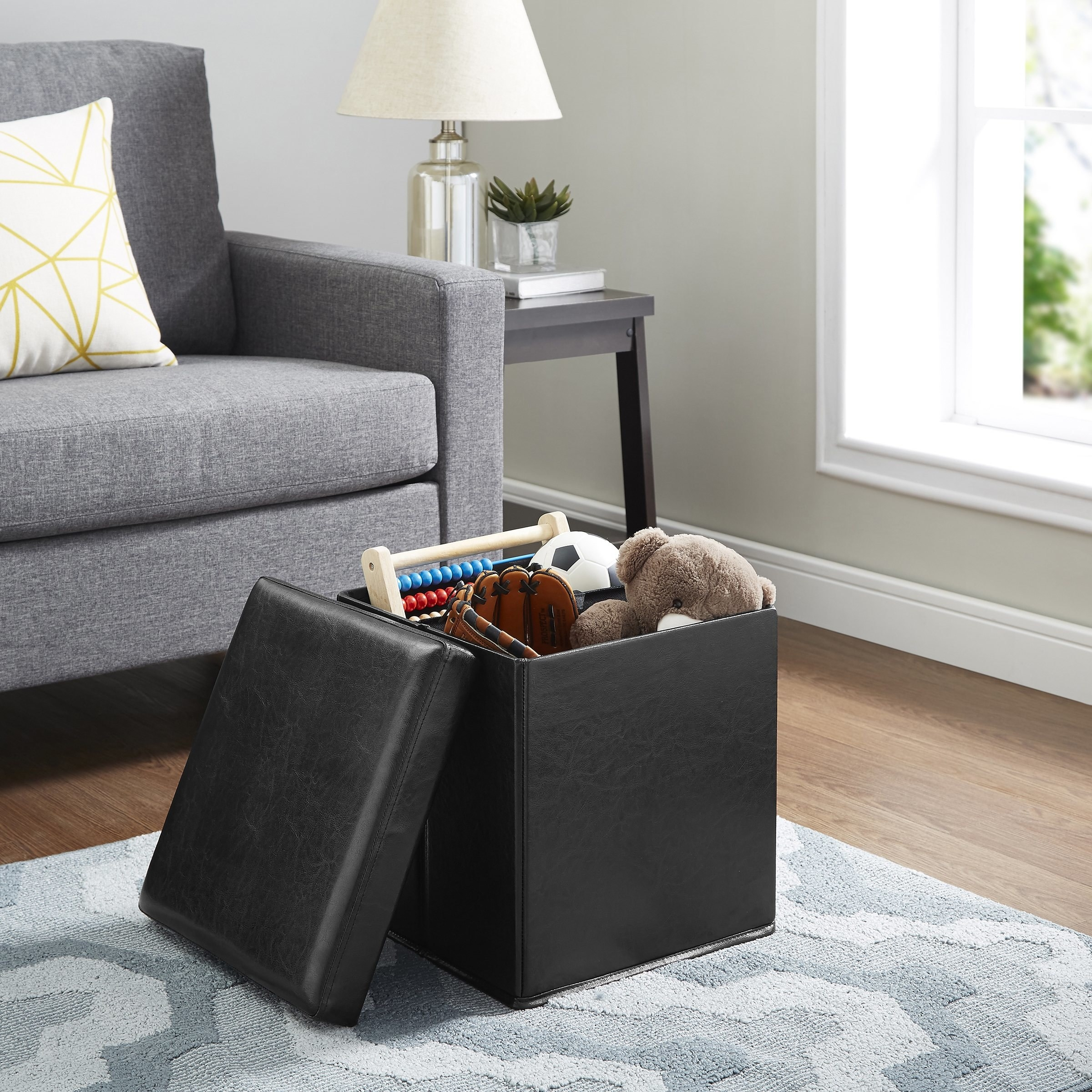 Theultra-collapsible faux leather storage ottoman