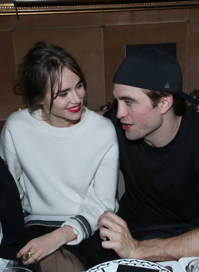 Suki and Robert sitting next to one another