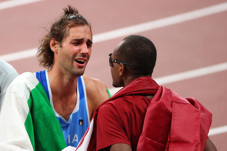 Tamberi looks emotionally at Barshim on the track