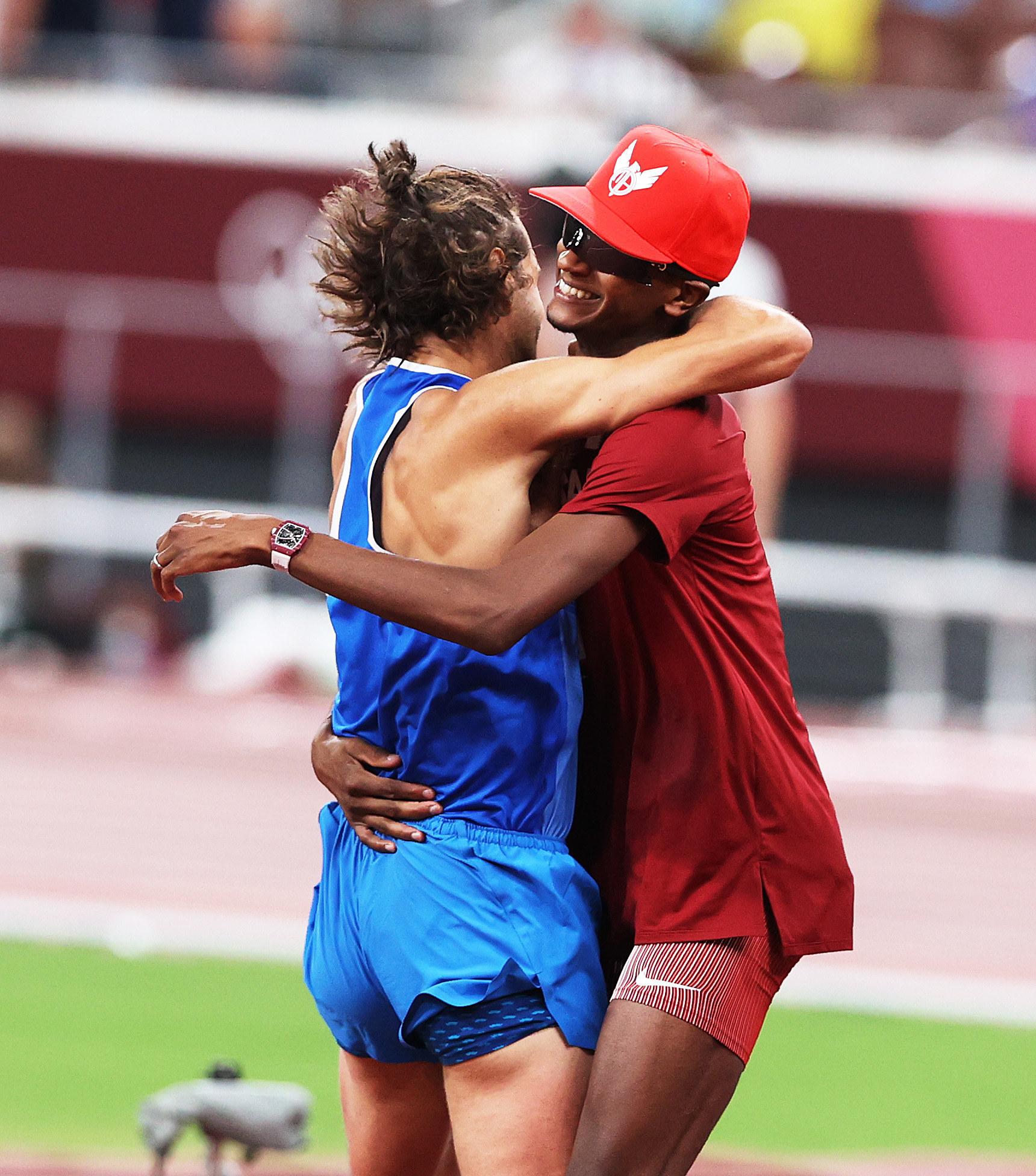 Tamberi and Barshim embrace