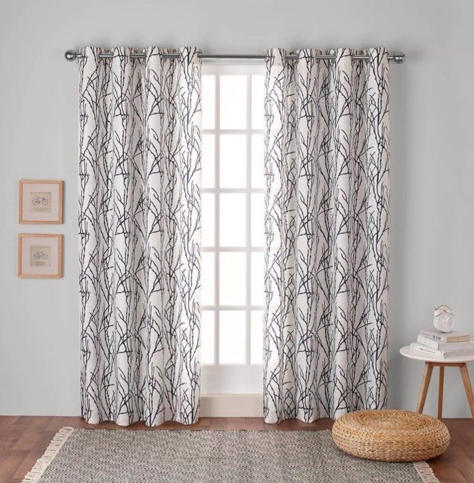the window curtains in white with black line patterns