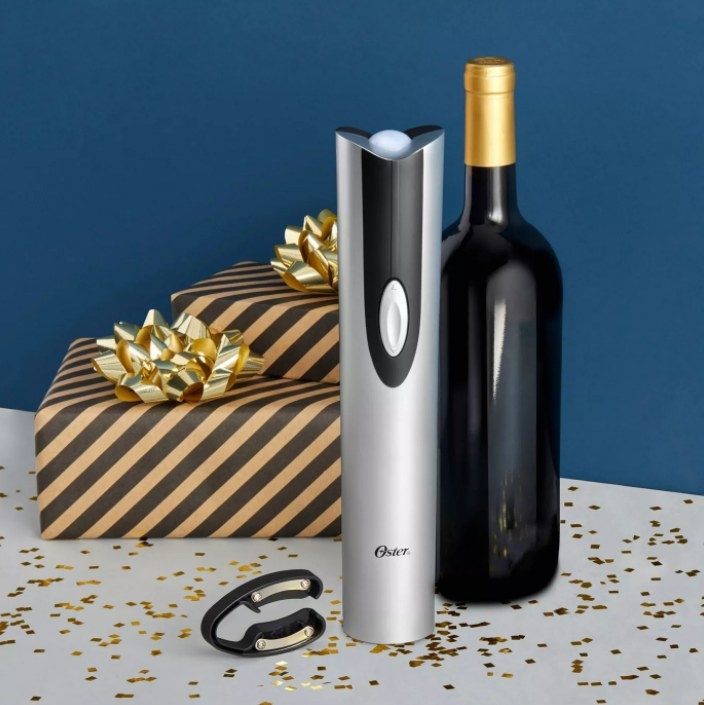 the wine opener next to a wine bottle and gifts