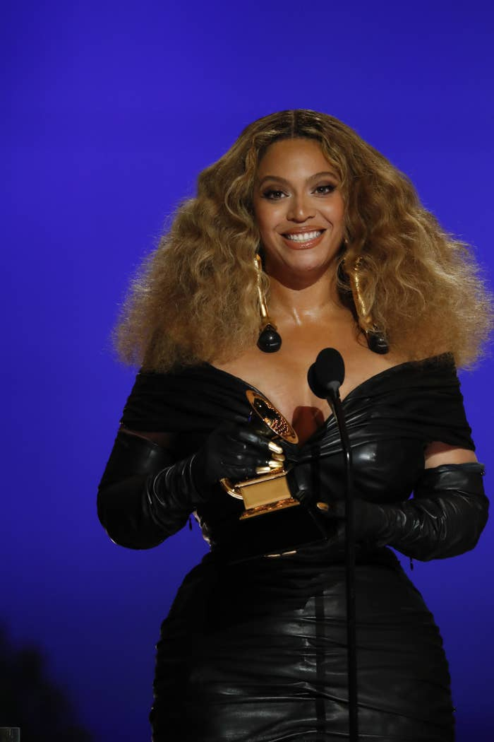 Beyoncé accepts an award for Best R&B Performance at the Grammy Awards in 2021
