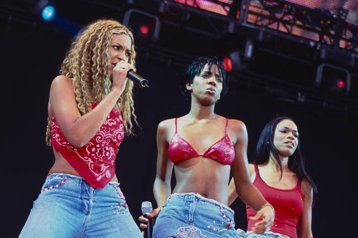 Beyoncé Knowles, Kelly Rowland, and Michelle Williams perform onstage as Destiny's Child in 2000