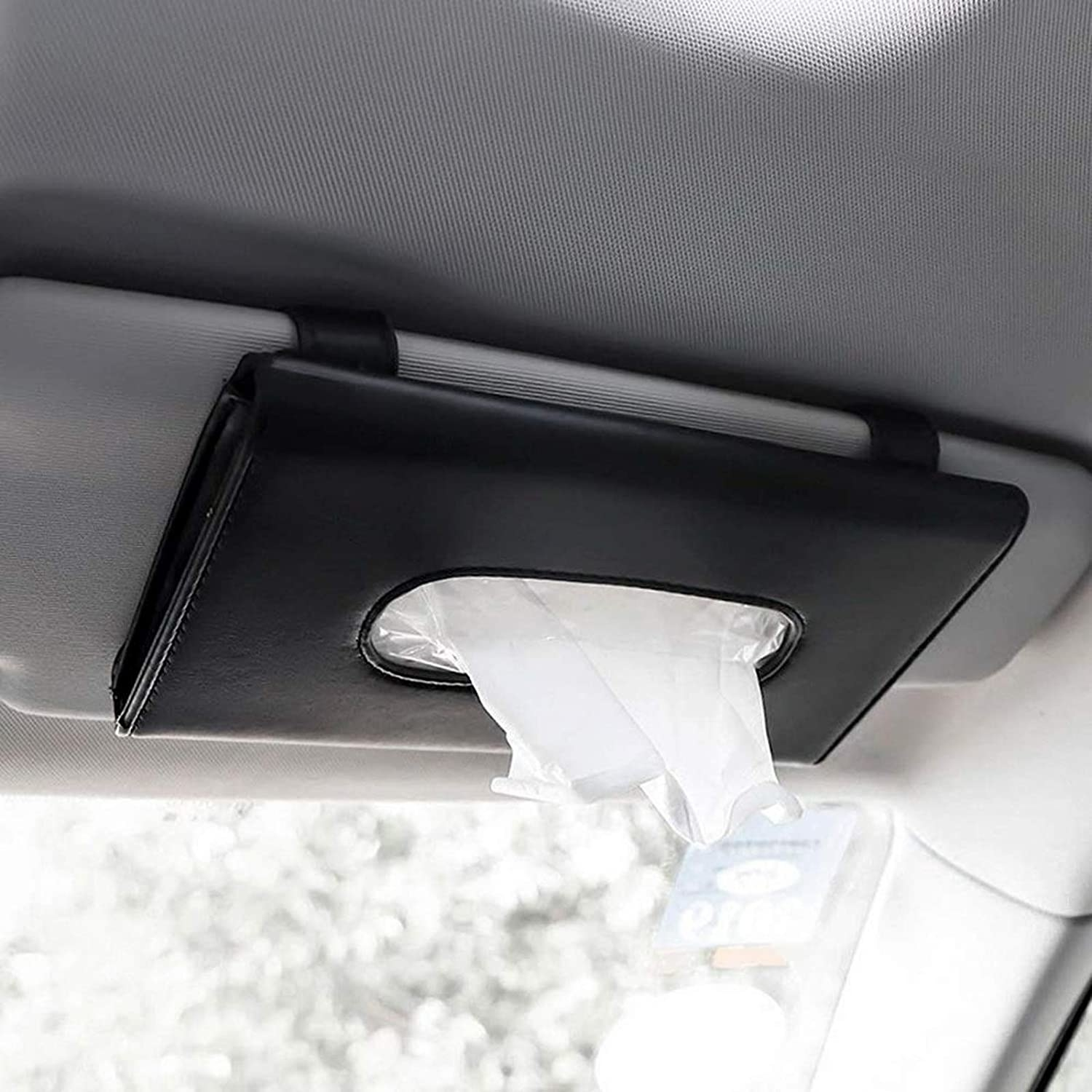 The tissue holder attached to a car visor