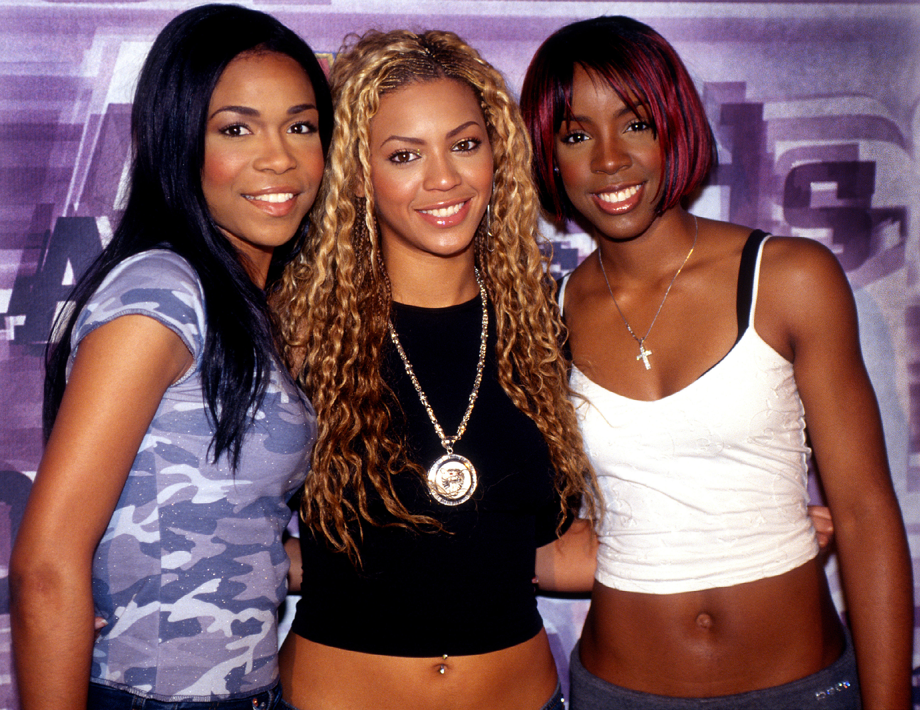 Michelle Williams,Beyoncé Knowles, and Kelly Rowland are photographed as Destiny's Child at an event in 2001