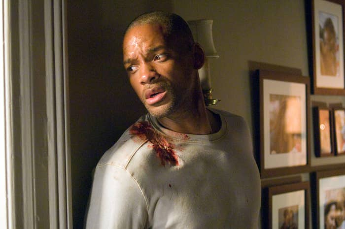 """A wounded Dr. Robert Neville,played by Will Smith, looks out a windowin """"I Am Legend"""""""