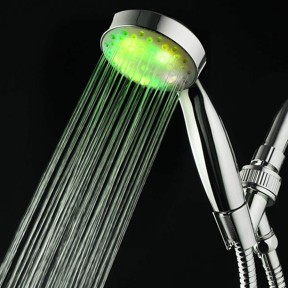 The lit up shower head with water coming out of it