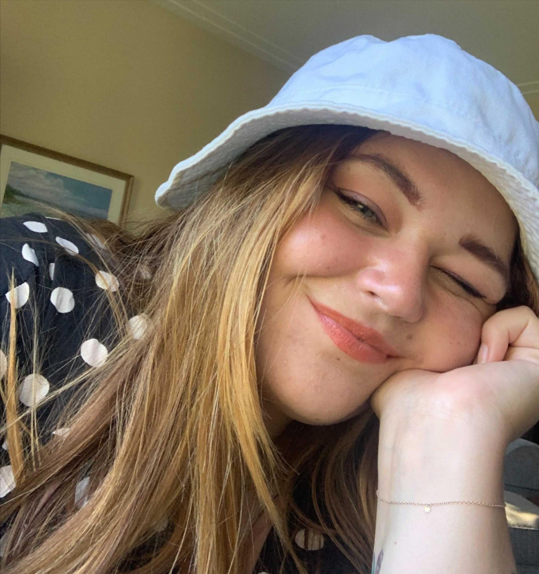 kristina smiling in a bucket hat