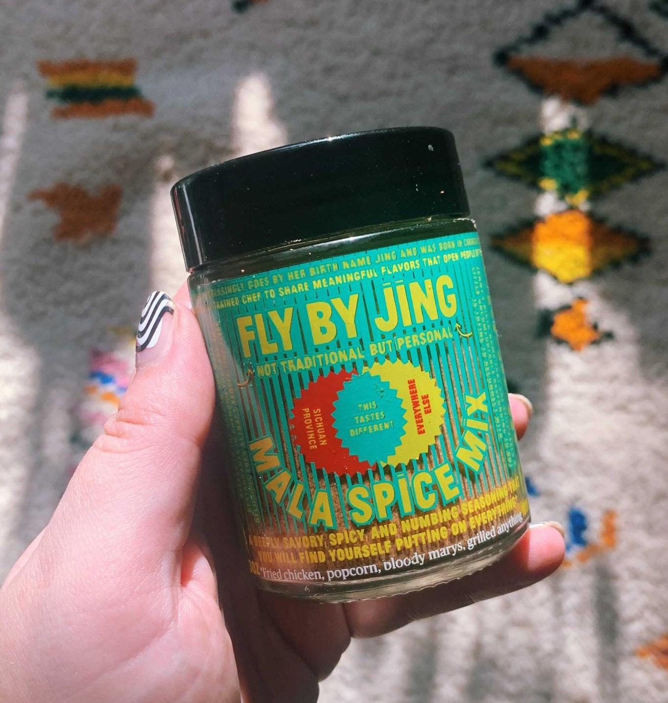 buzzfeeder holding a jar of Mala Spice Mix