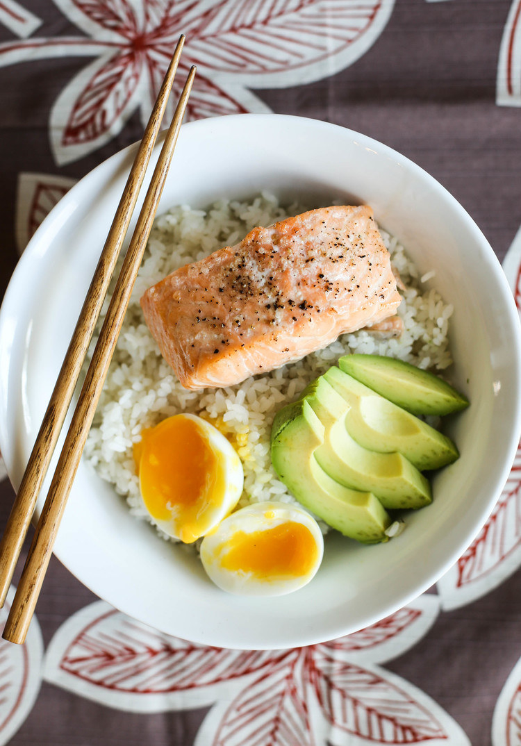 A rice bowl with salmon, egg, and avocado