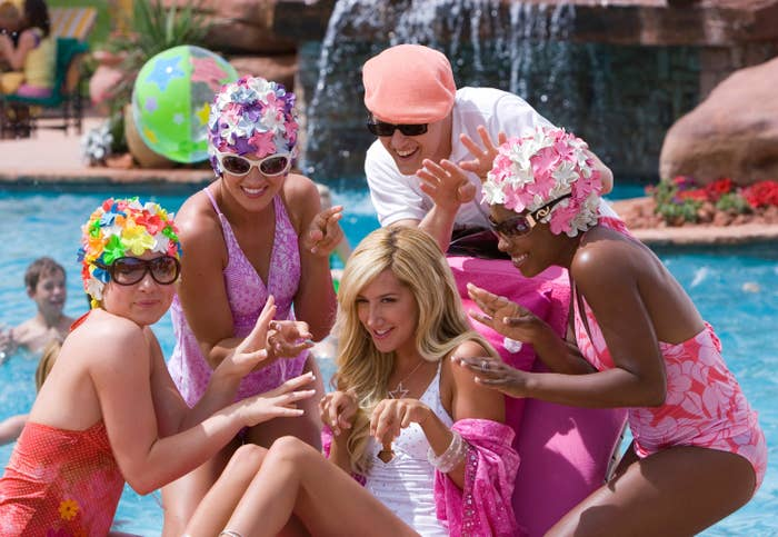 Sharpay surrounded by people at a pool
