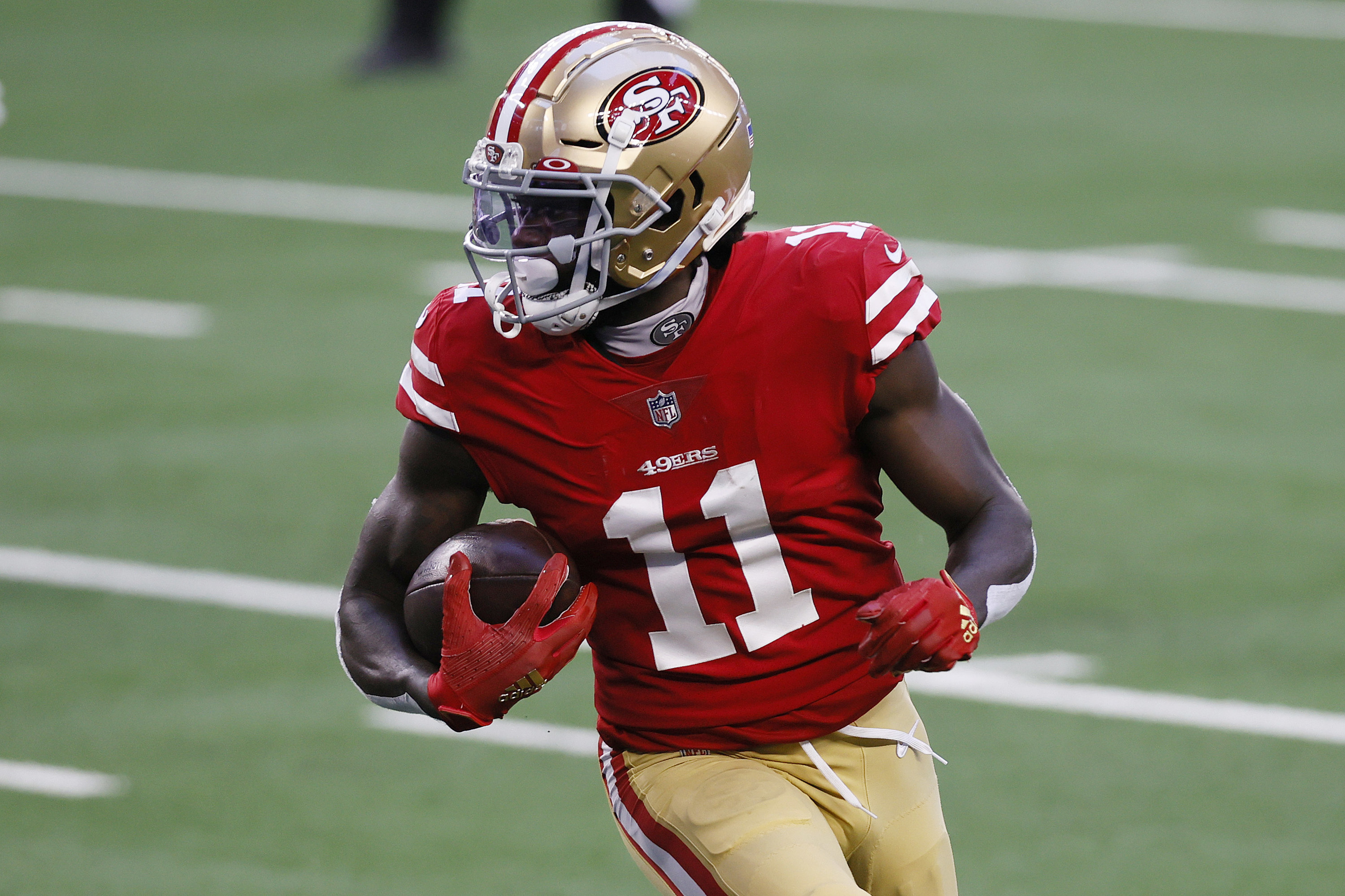 Red and bronze 49ers uniforms