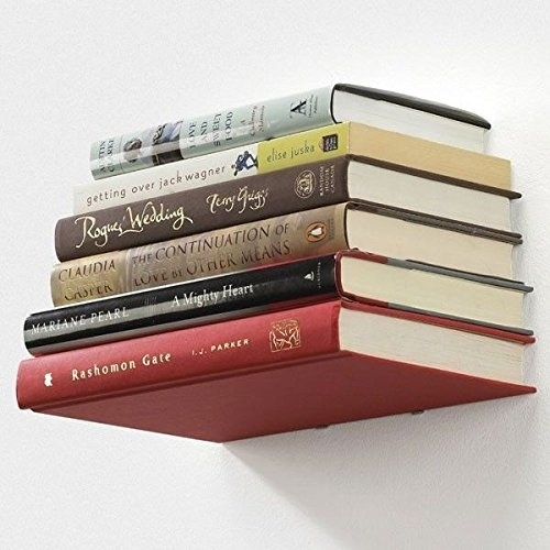 Floating shelves with books on them