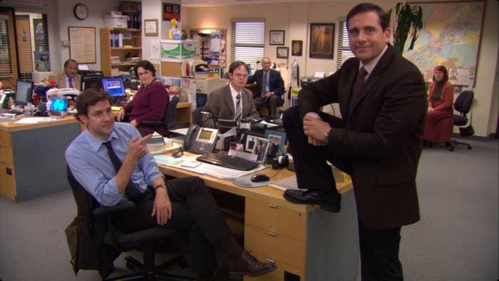 Michael puts his foot on Jim's desk
