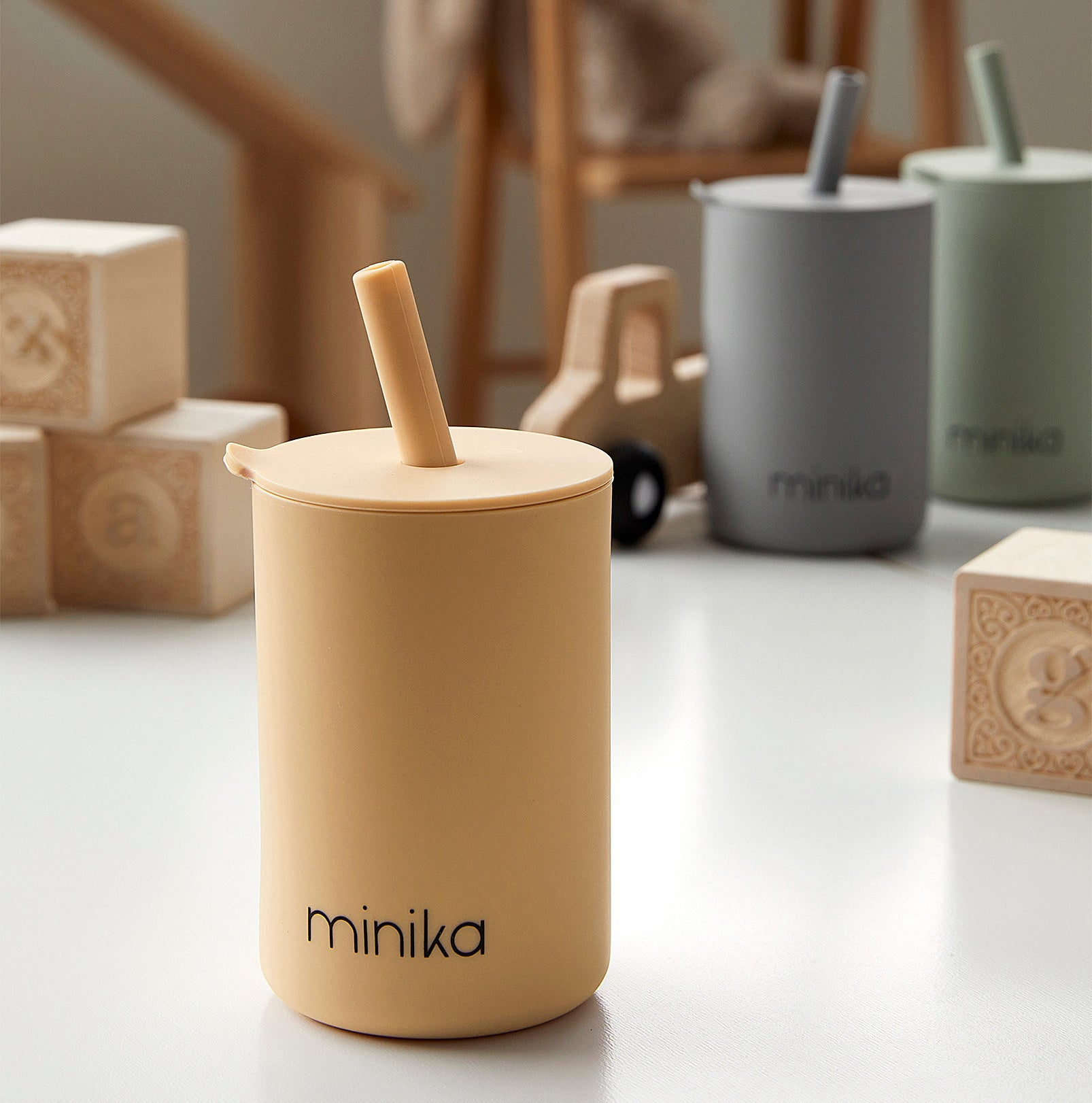 a silicone tumbler with a silicone straw on a table