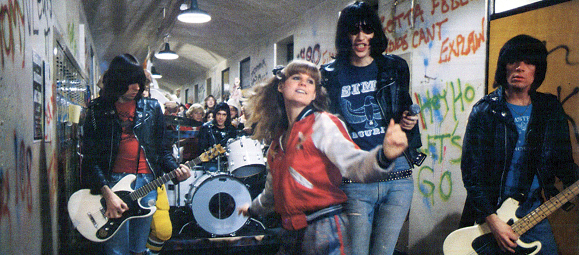 The Ramones playing in a hallway in the film Rock 'n' Roll High School.