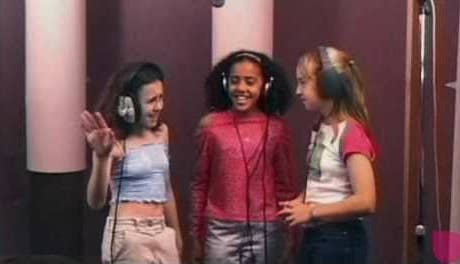 """Lisa, Carole and Stevie singing and dancing while in a studio recording """"Hello World"""""""