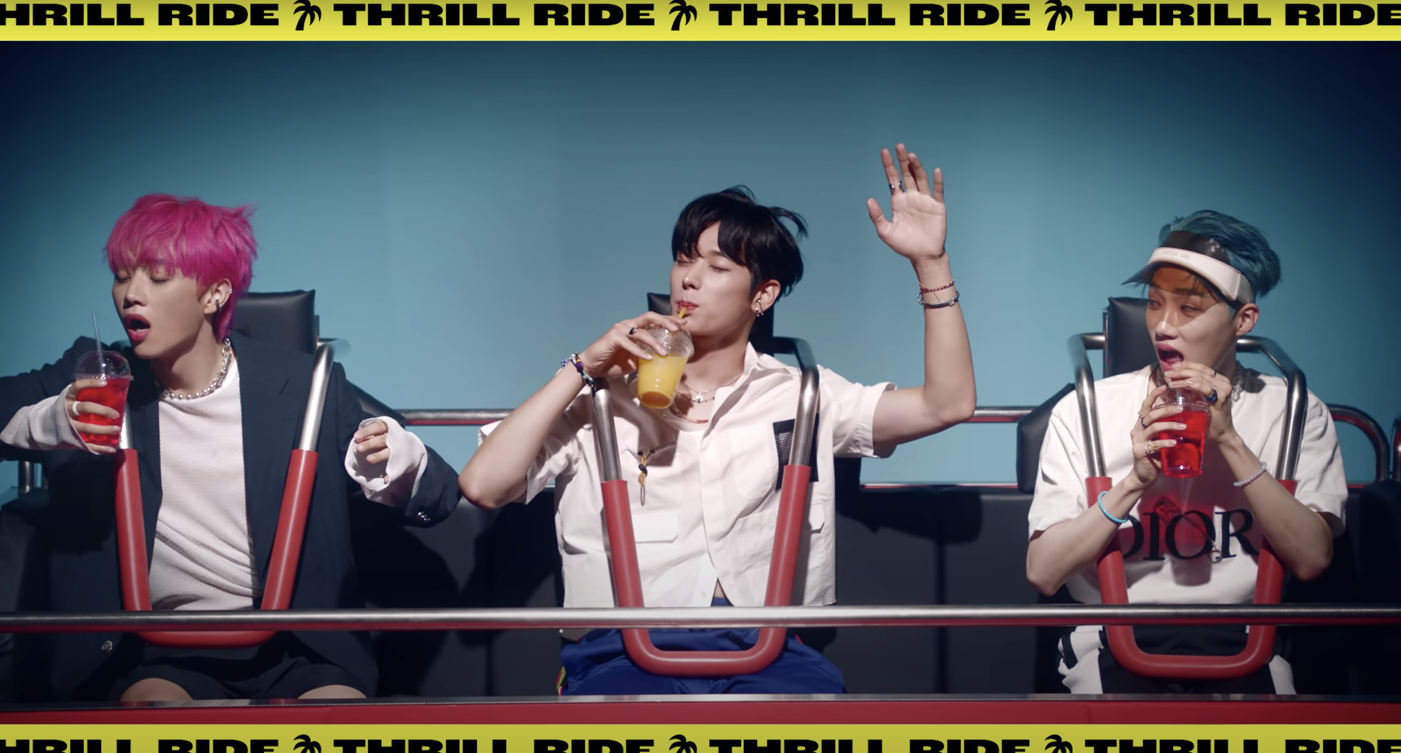 """Three members ride a roller coaster during the """"Thrill Ride"""" announcement"""