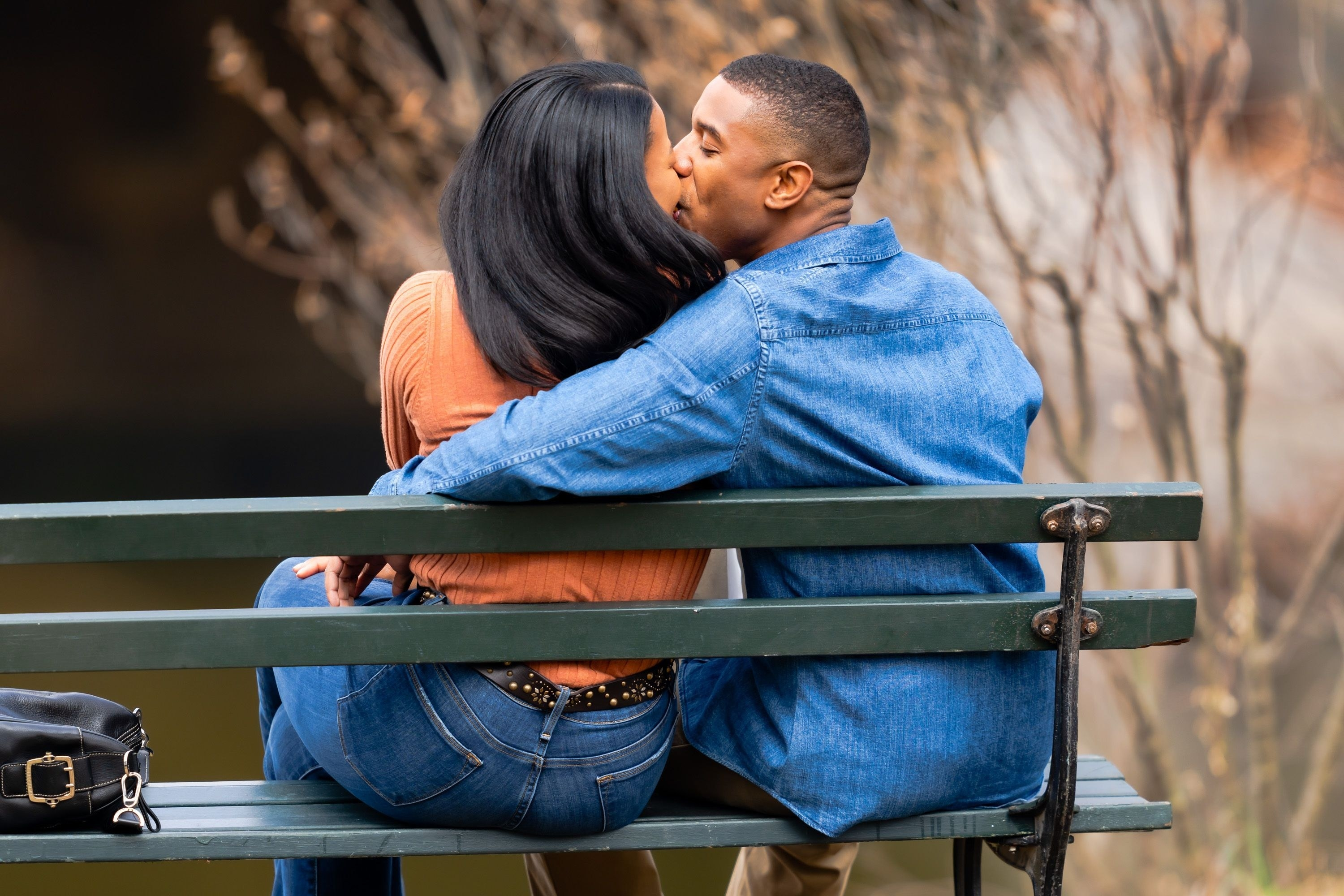 Michael's character kissing his wife as they sit on a bench in a scene from the film