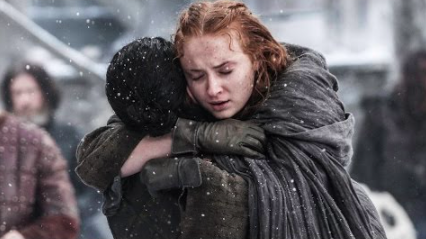 Sansa and Jon hug and embrace in the snow