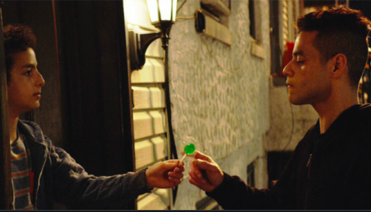 Trenton's brother gives Elliot a lollipop