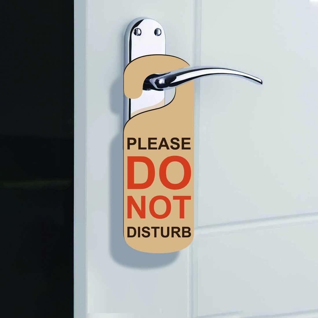 "A ""Do Not Disturb"" sign on a door handle"
