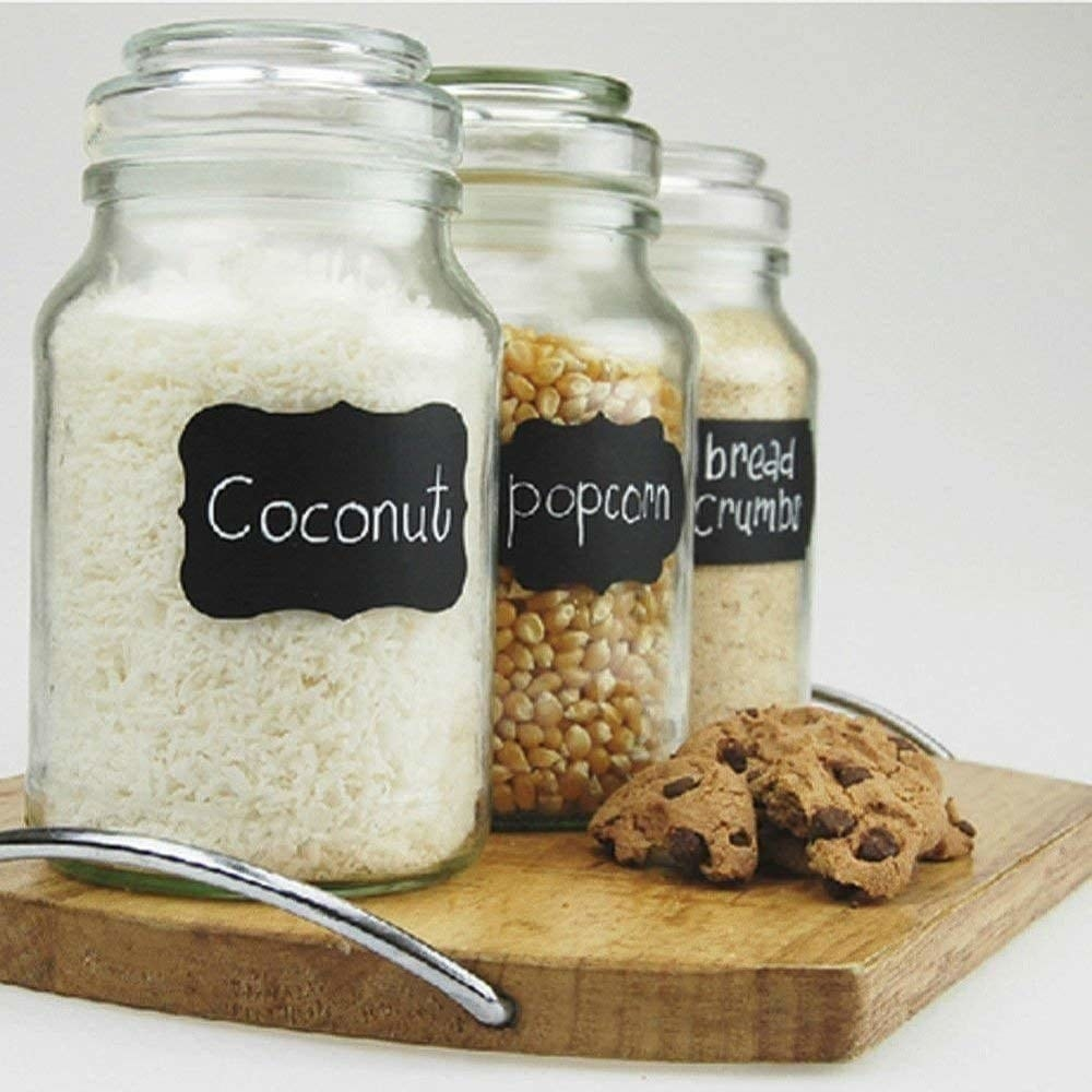 Food labels marking jars of desiccated coconut, popcorn, and bread crumbs