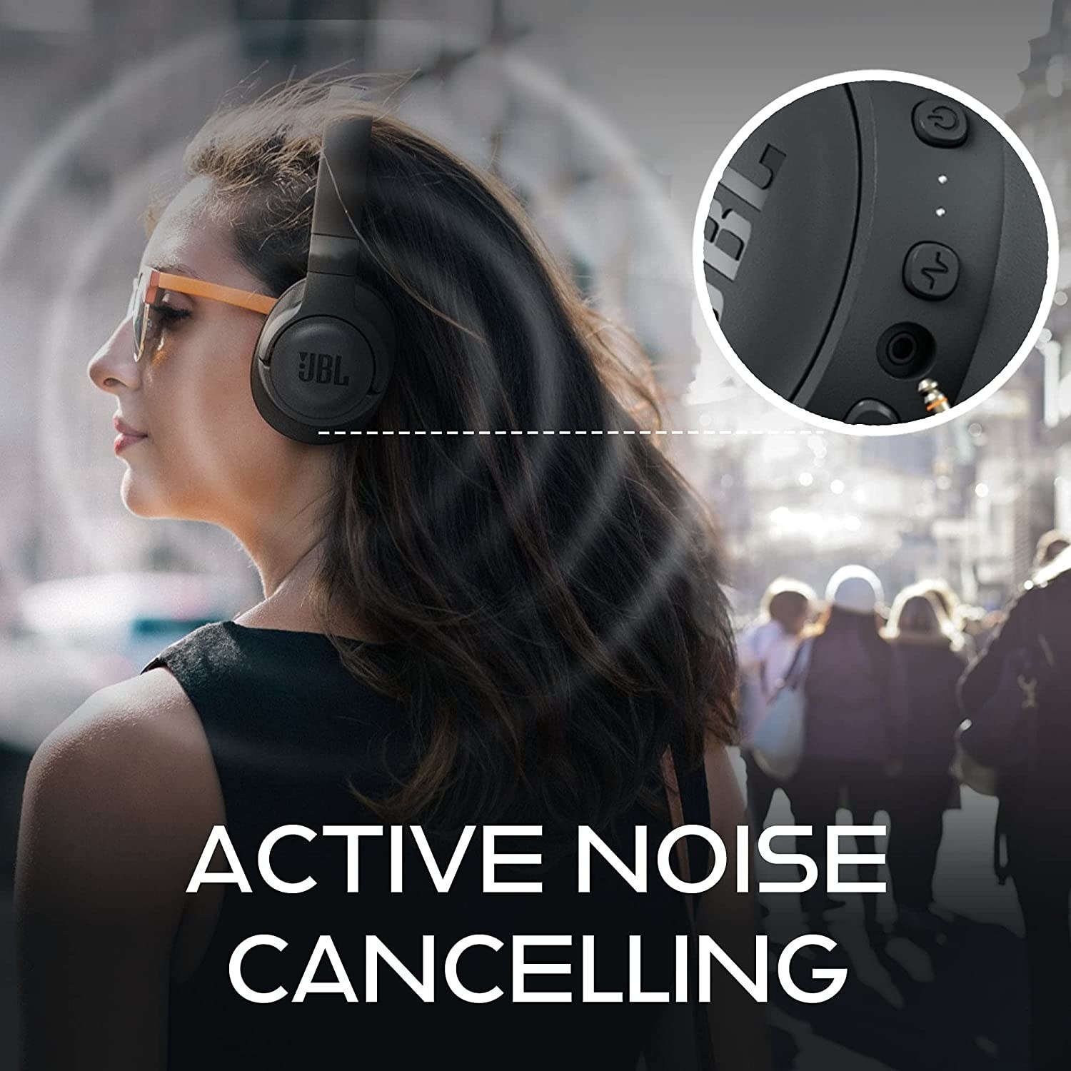 A person wearing the noise cancelling headphones