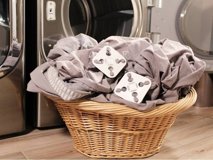 sheets in a basket with the clips on the ends to keep them from tangling up