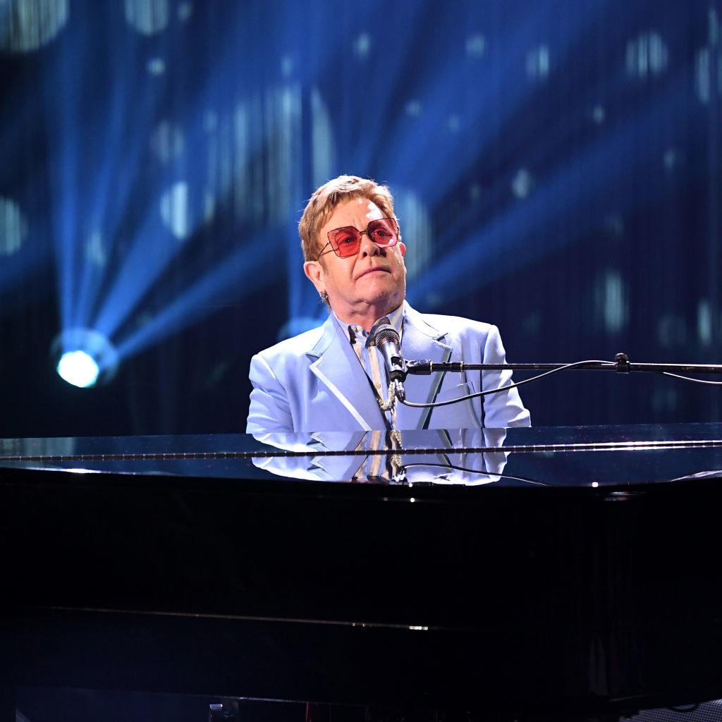 """""""Rocket Man"""" singer at the piano"""