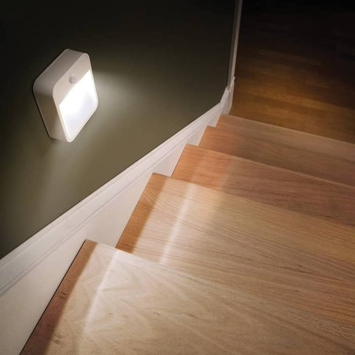 Night lights installed on the staircase wall where there are no outlets