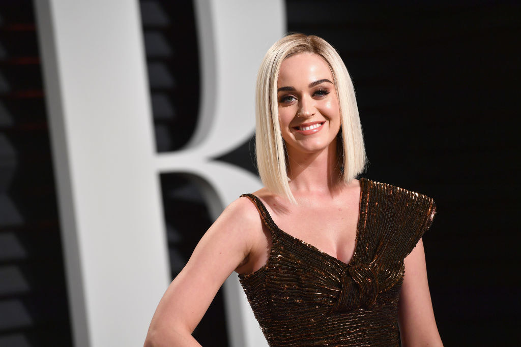 Katy in a sparkly outfit and smiling