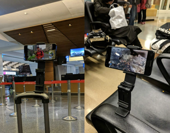 Phone mounted on a carry on luggage handle and a chair arm