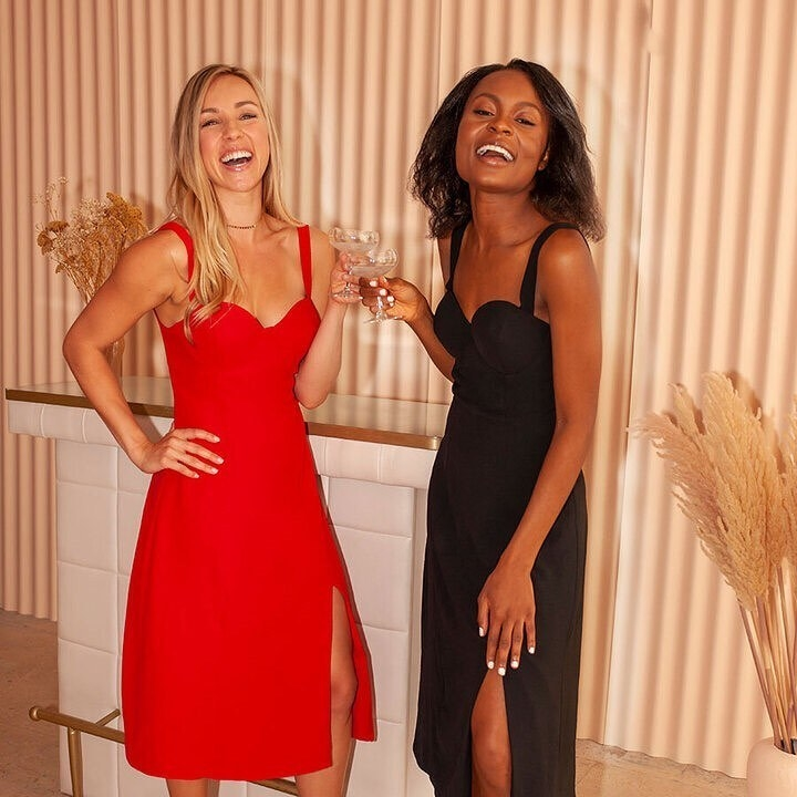 two models wearing the mid-calf-length dress with sweetheart neckline in red and black