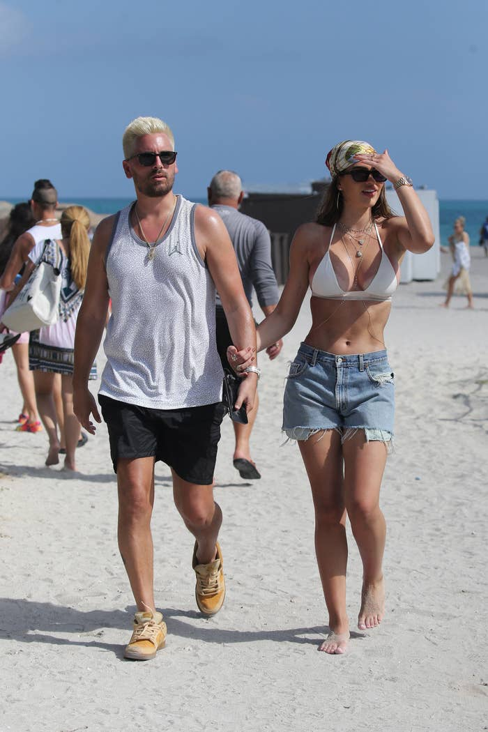 Scott Disick and Amelia Gray Hamlin are photographed walking on the beach in Miami, Florida