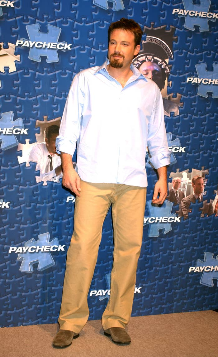 Ben at a movie premiere wearing a blue button-down untucked and khaki pants.