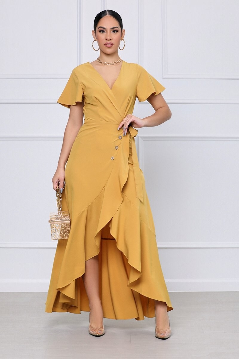 model wearing the high-low wrap maxi dress with a tie skirt and buttons in mustard yellow