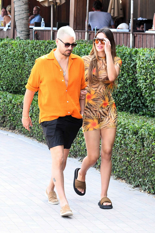 Scott Disick and Amelia Gray Hamlin are photographed walking near the beach in Miami, Florida