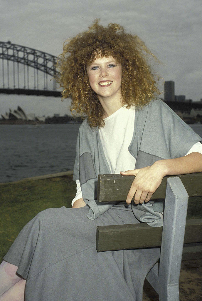 in Sydney with very very curly hair
