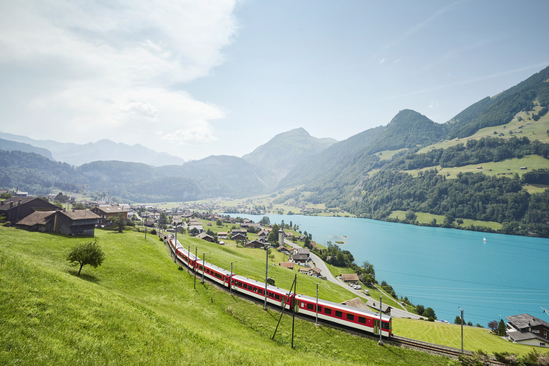 A train passing Lake Lucerne.
