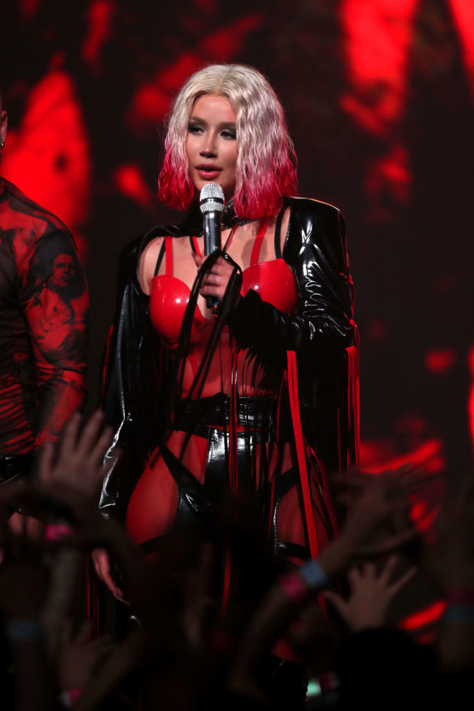 Iggy Azalea in a red and black outfit on stage