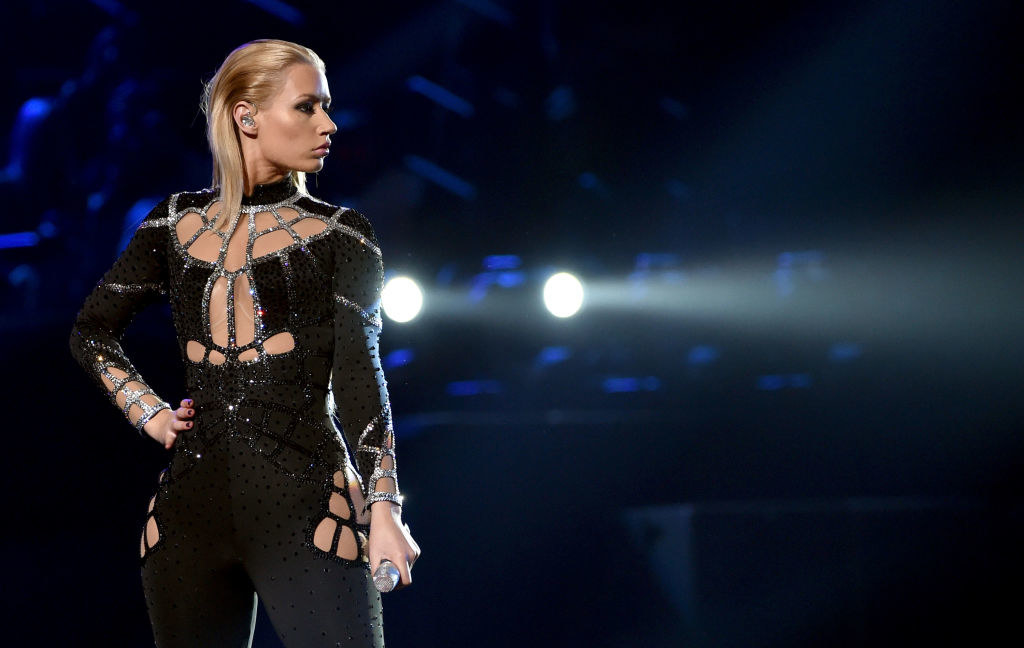 Iggy in a black, glittery outfit on stage